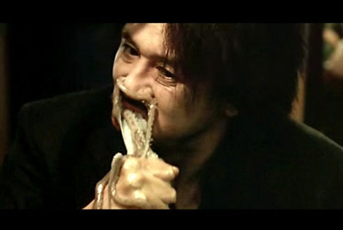 Oldboy (2003): Eating a live octopus