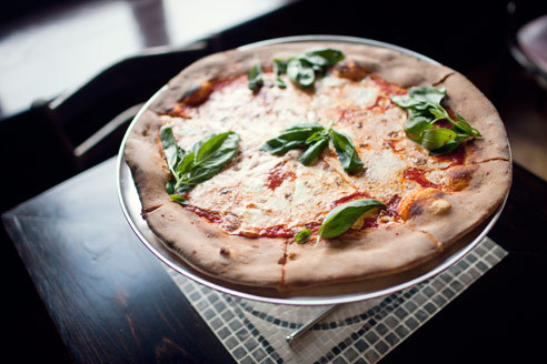 Margherita at Giuseppina'sPizzaiolo  Chris Iacono---brother to Lucali owner Mark---does the family's legacy  right with these finely wrought specimens. Supple pies, blistered in a  hand-built, wood-fired oven, are adorned with a slick of tangy tomato  sau