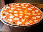Vodka pizza at RubirosaEach  year seems to spawn a new pretender to NYC's pizza throne, but this  newcomer actually approaches pantheon status. Rubirosa's crisp yet  pliable thin-crust pies have a delicate char and a small ring of  crackerlike crust aroun