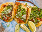 Al pastor tacos at Taco MixThe signature al  pastor pork is sliced directly from the spit at this Spanish Harlem  hole-in-the-wall, which is so tiny that you have to eat standing up.  You'll forget about the cramped quarters as soon as you taste that juic
