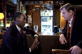 Don Cheadle and Brendan Gleeson in The Guard.