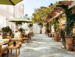 Pets are welcome in The Yard at SoHo Grand Hotel.