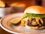The Cardinal This refreshingly simple cheeseburger reminds us of the best kind of  backyard cookout. While there's no charcoal grill hiding in his kitchen,  North Carolina native Curtis Brown does right by the proprietary  Ottomanelli Brothers patty, trap
