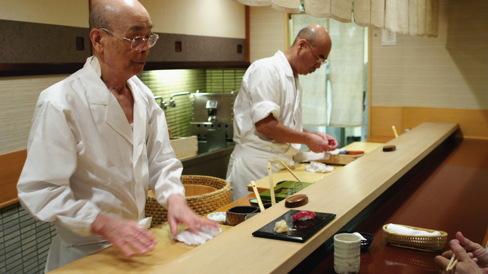 Jiro Ono, left, and Yoshikazu Ono in Jiro Dreams of Sushi