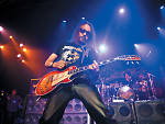 In this photo provided by Hard Rock Cafe, KISS guitarist Ace Frehley rocks New York's Hard Rock Cafe, Wednesday, Oct. 31, 2007, to celebrate Halloween and his new band.  (AP Photo/Hard Rock Cafe, Diane Bondareff)
