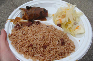 The Jamaican Dutchy's jerk chicken with rice and beans and cabbage