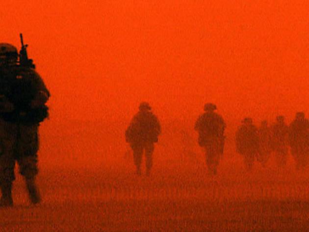 RED DESERT U.S. troops tromp across a colorful battlefield.
