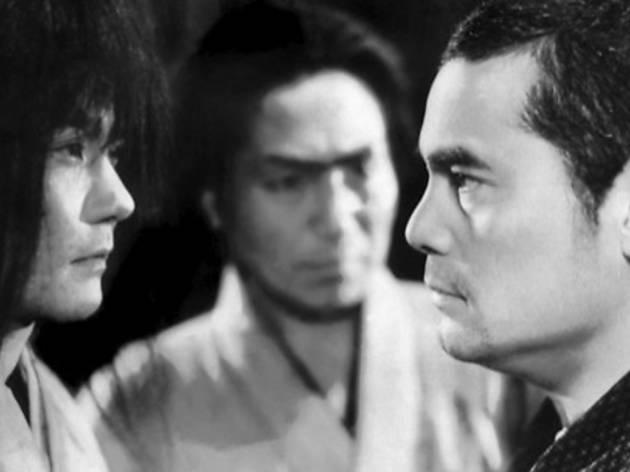 FACE/OFF Susumu Fujita, right, stares down his opponent in Sanshiro Sugata, Part II.