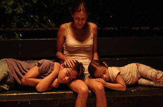 AFTER DARK, MY SWEETS Mendoza and her children bed down on a park bench.