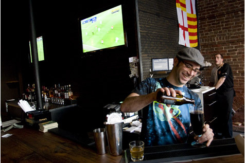 Woodwork co-owner Eric Bernstein pours a pint