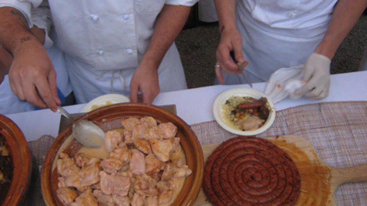 Team DB Bistro Moderne dishes up their Moroccan meal of yogurt-harissa roasted chicken and house-made merguez sausage