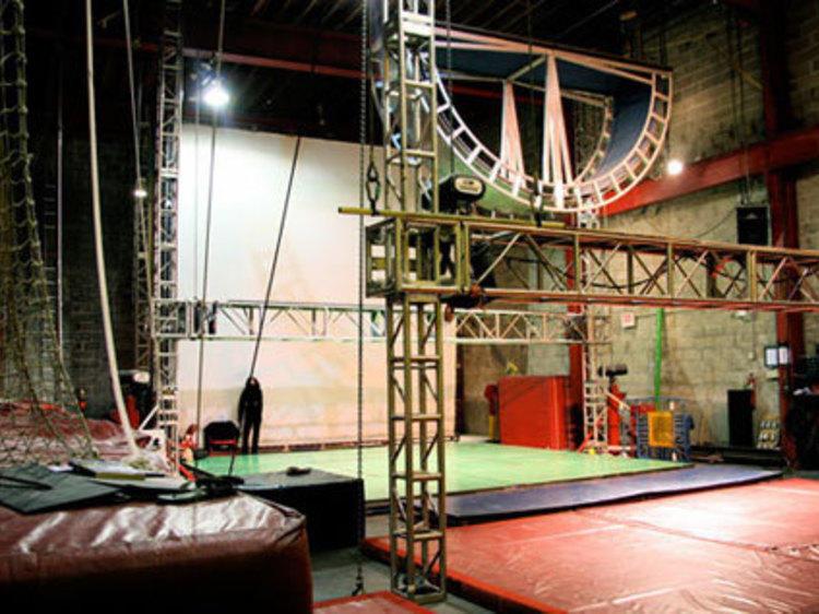 Fly through the air at the España-Streb Trapeze Academy