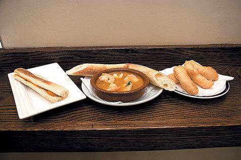Sea urchin panino, garlic shrimp and salt-cod nuggets at El Quinto Pino