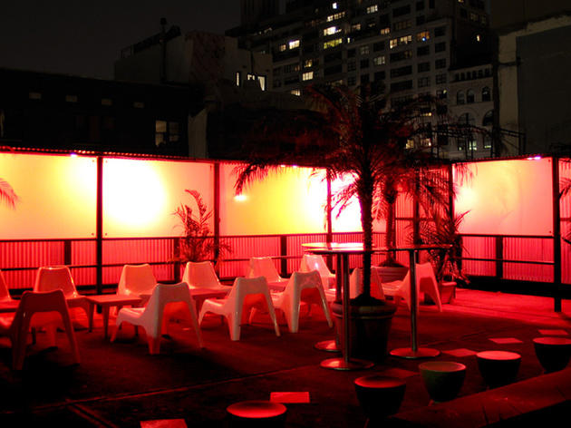 Bar 13's roof deck transforms at night when the light panels in the walls emit a warm orange hue.