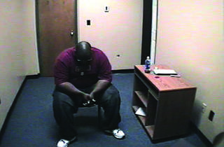 Adrian Thomas waits alone in an interrogation room in Scenes of a Crime