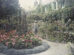 Claude Monet in front of his house at Giverny