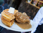 Smothered chicken and waffles at Sylvia's