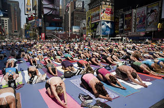 Thousands of yogis are taking over Times Square to celebrate the summer solstice