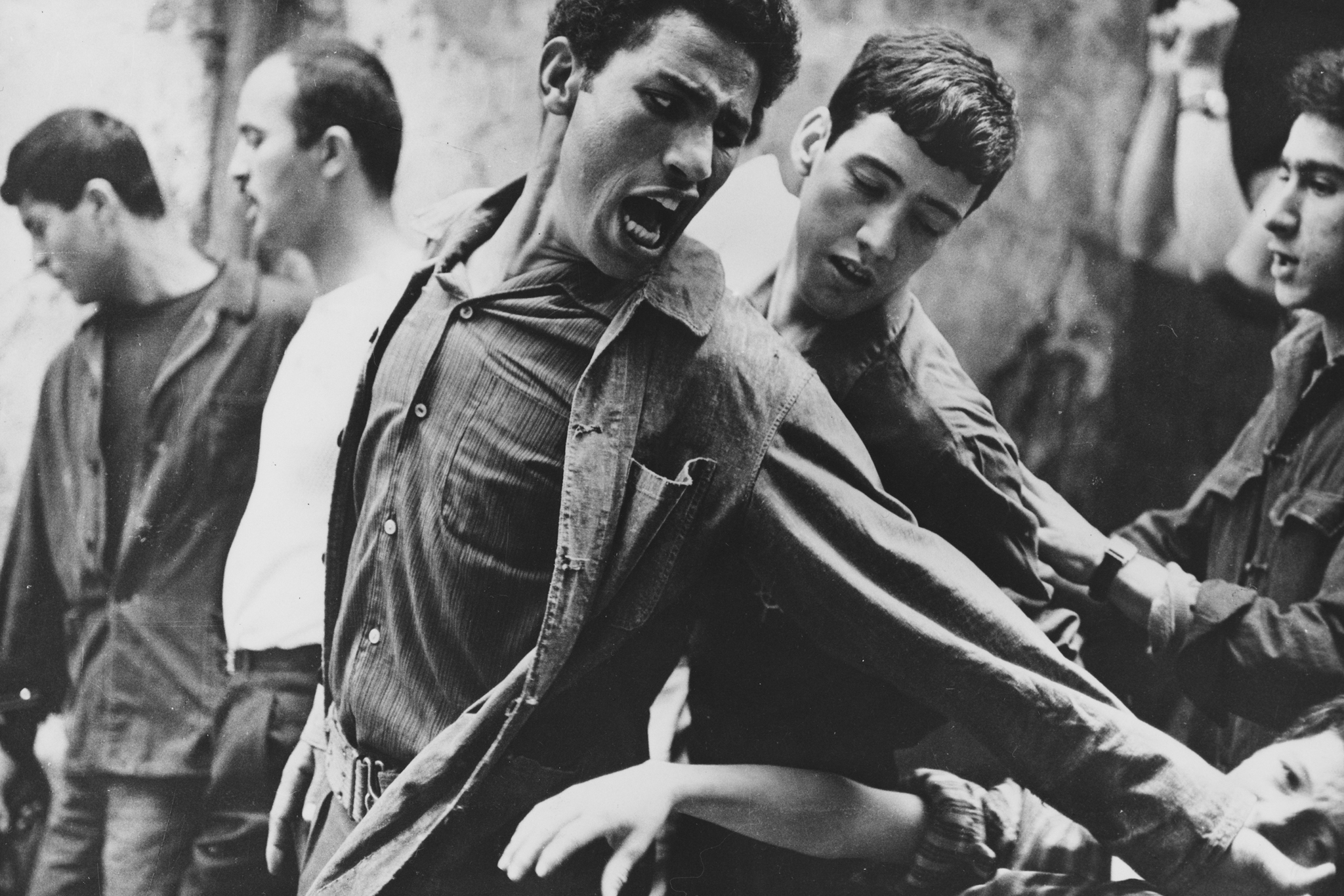 Brahim Haggiag, center, in The Battle of Algiers