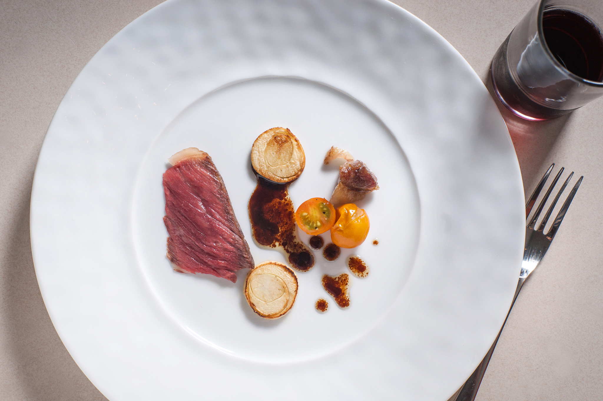 <p>Wagyu with vincotto, hearts of palm and Sun Gold tomato at Blanca</p>