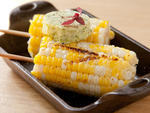 Corn on the cob with roasted garlic and jalapeno at Woodland