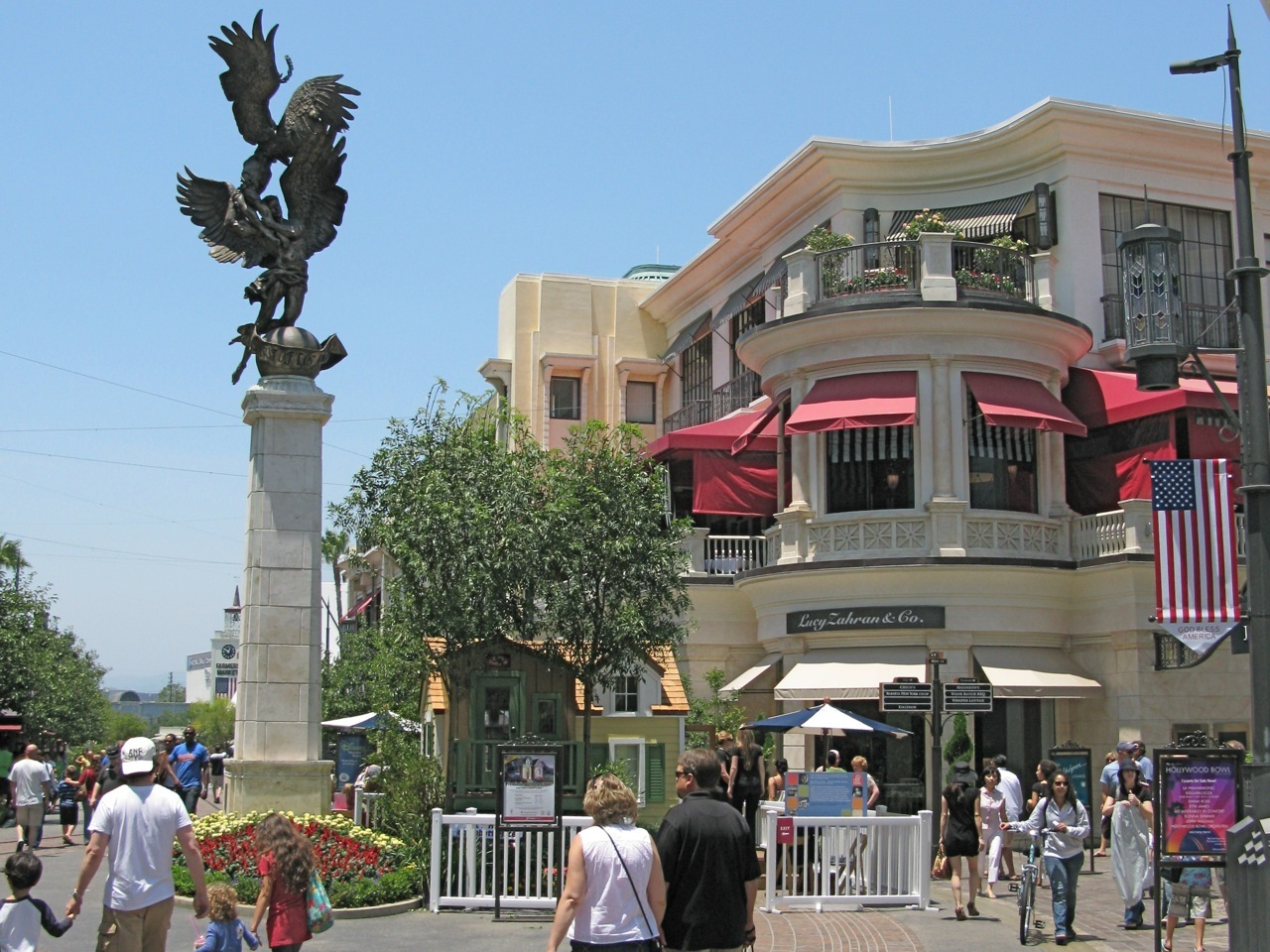 The Spirit of Los Angeles Statue created by sculptor De L'Esprie, shows male and female angels reaching to the heavens. The foot sculpture stands on a foot column at The Grove shopping center in Los Angeles. The spinning marquee of the art-deco-inspired movie theater is designed to be seen from anywhere in the mall.