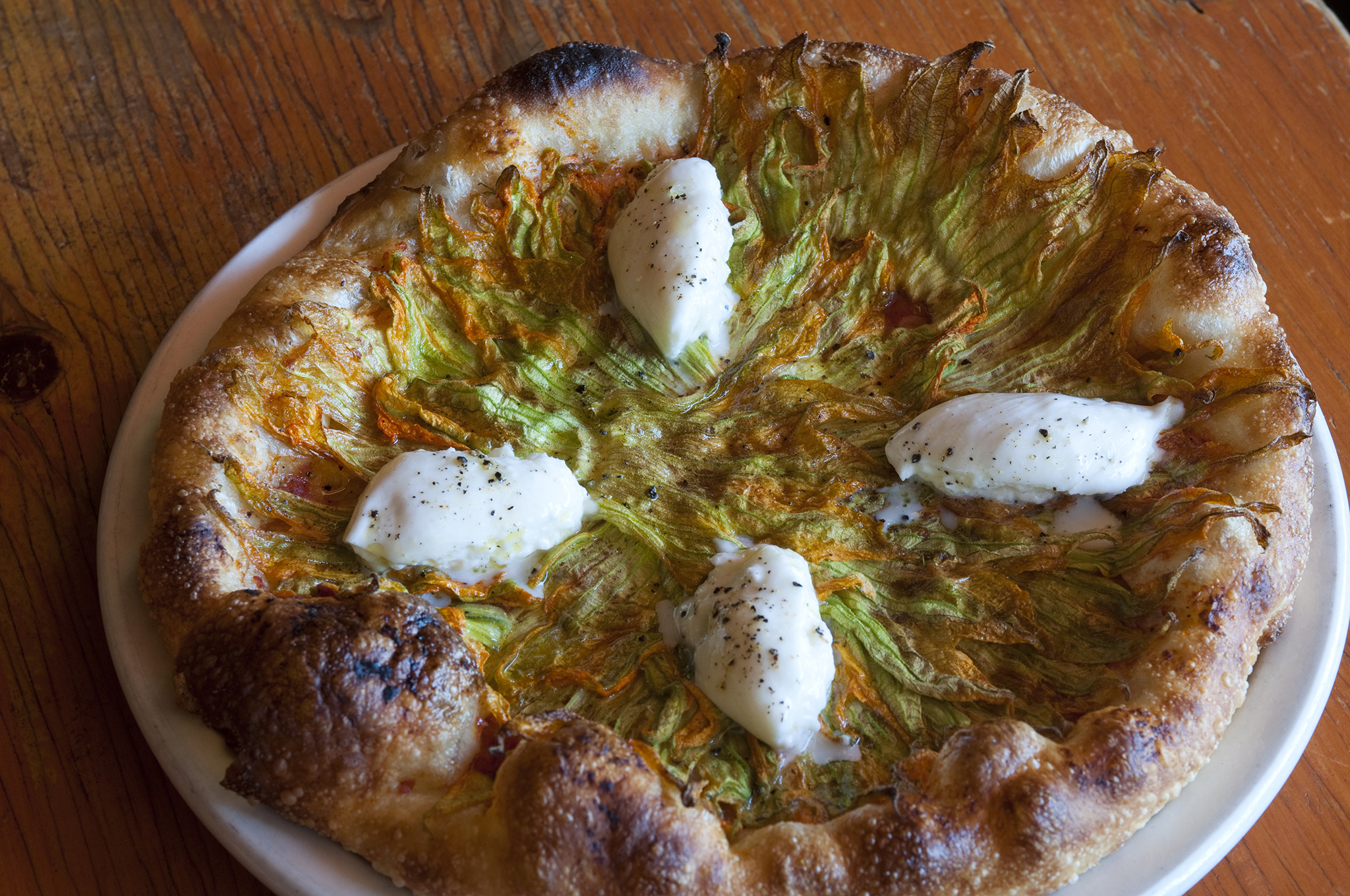 Pizza with squash blossoms and burrata at Pizzeria Mozza