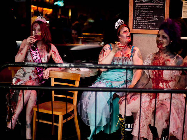 Gore-ified models kick back and relax after their debut at the Zombie Fashion Show