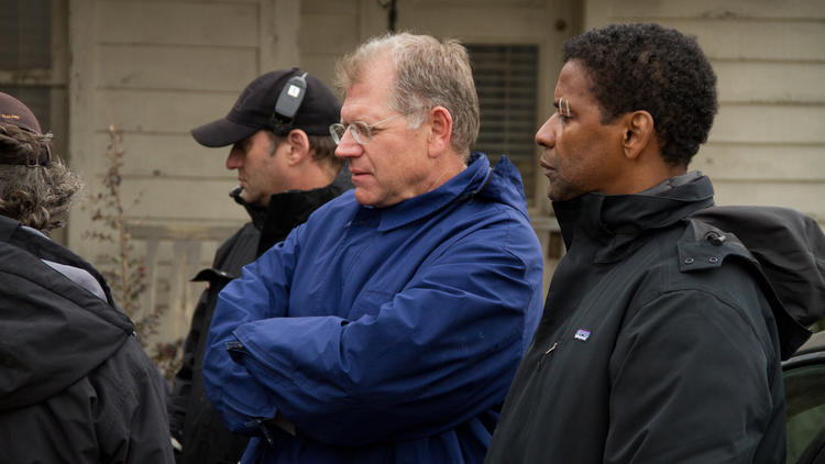 Filmmaker Robert Zemeckis, left, and Denzel Washington check out a shot on the set of Flight