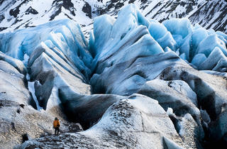 An Extreme Ice Survey team member checks out a glacier in Chasing Ice.