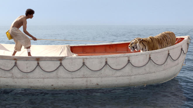 Suraj Sharma and a Bengal tiger named Richard Parker in Life of Pi