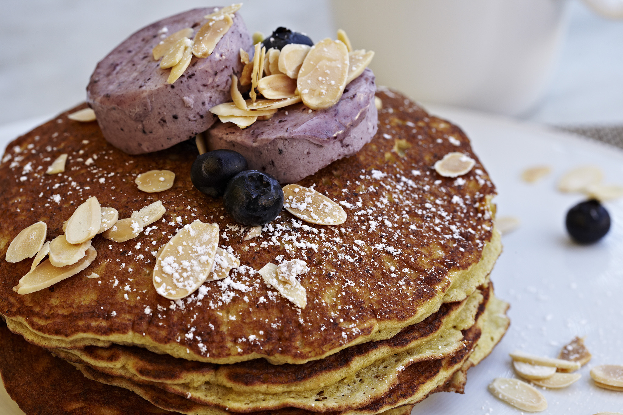 Lemon ricotta pancakes with almond-blueberry butter at Fig