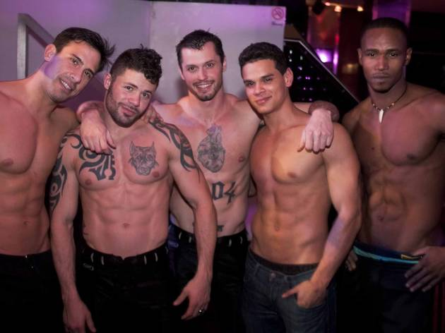 Watch hot dudes strip at Muscle Mania