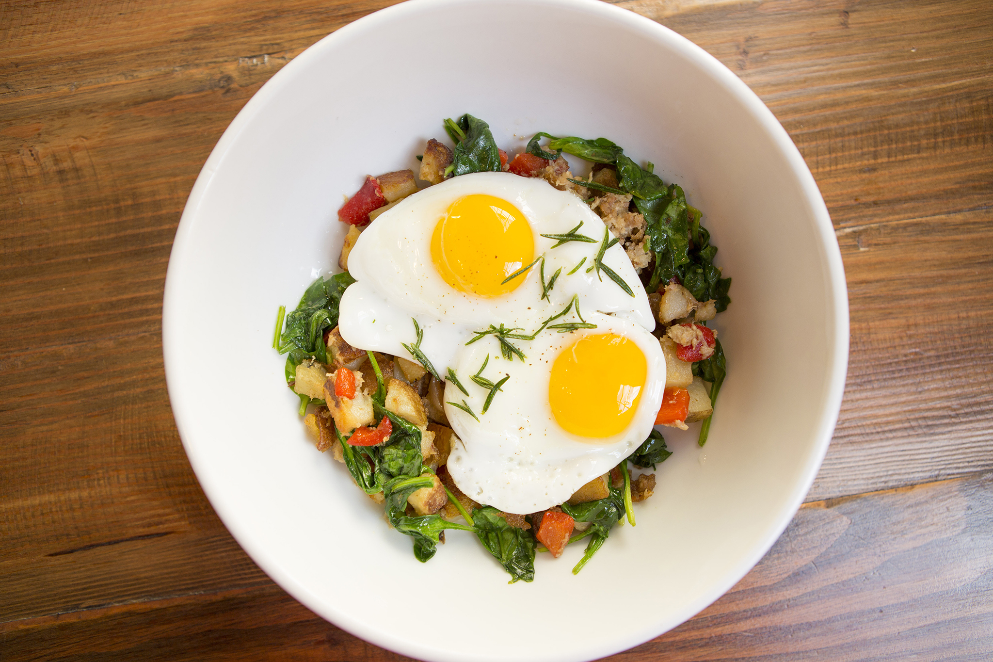 Pork belly hash, potatoes, spinach and two fried eggs at Sycamore Kitchen