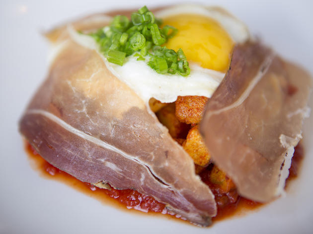 Sunny side up duck egg, jamon, romesco and patatas bravas at Superba Snack Bar