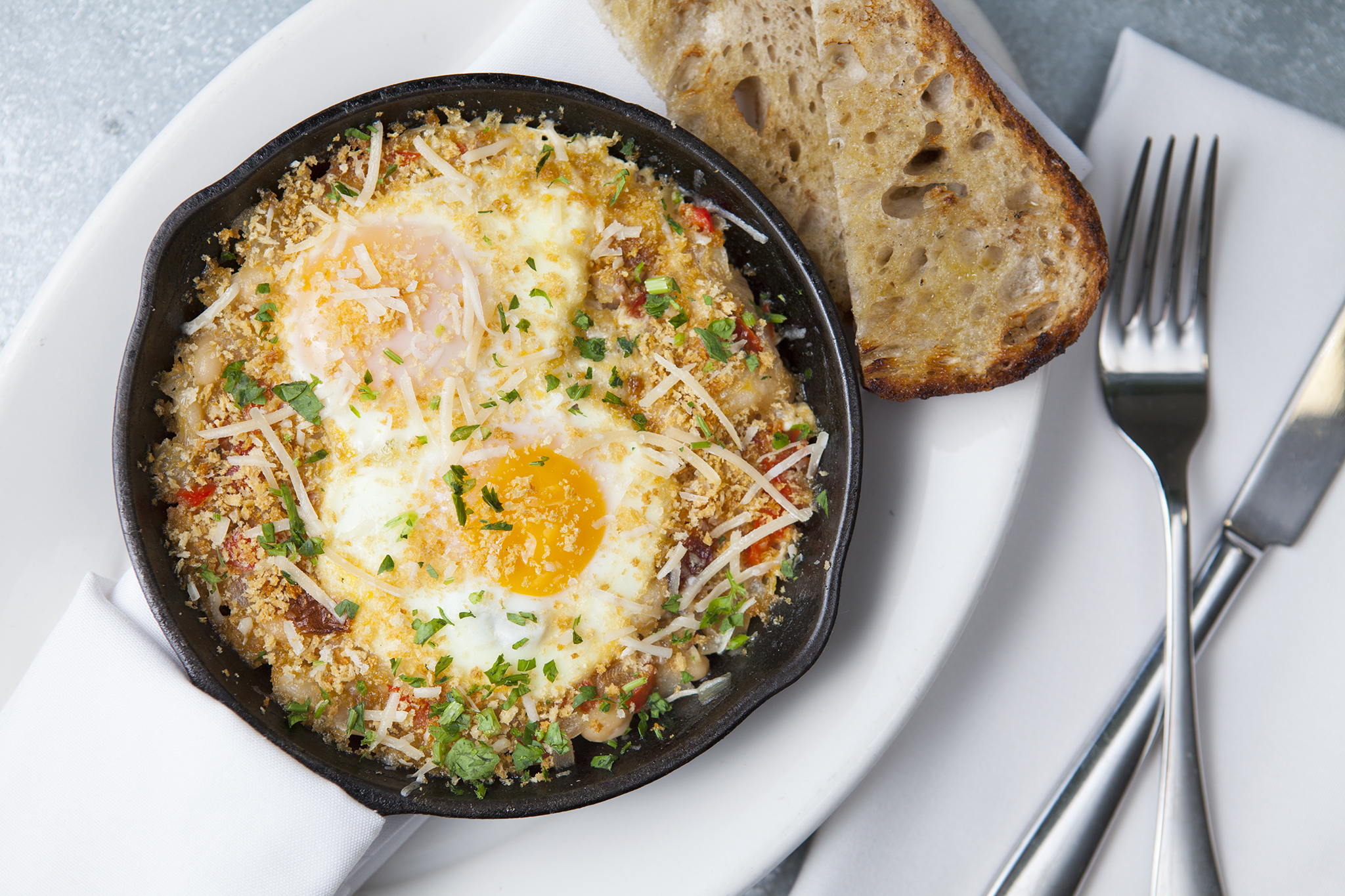 Baked eggs with white beans and Prosciutto sofrito at Tavern