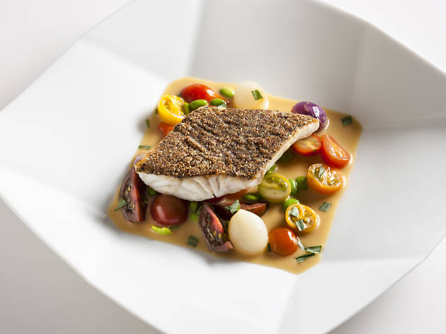 Black sea bass crusted with nuts and seeds with a sweet and sour Jus prepared by Chef Jean Georges and Chef Gregory Brainin of Jean Georges restaurant in NYC