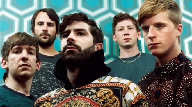 Horse power: Yannis Philippakis (centre) and Jimmy Smith (second left) with Foals