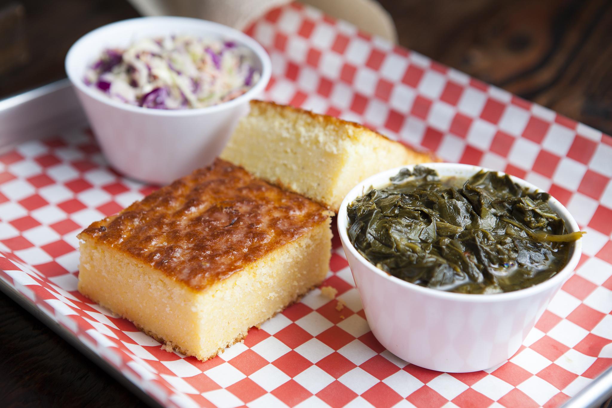 Corn bread, collard greens and cole slaw at Bludso's BBQ