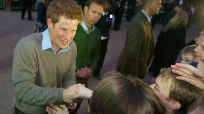 Prince Harry greets his legions of fans