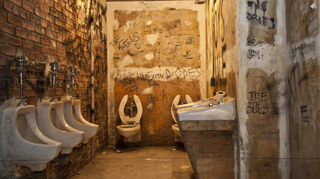 "A recreation of the CBGB's bathroom at ""Punk: Chaos to Couture"" exhibit at the Metropolitan Museum of Art"