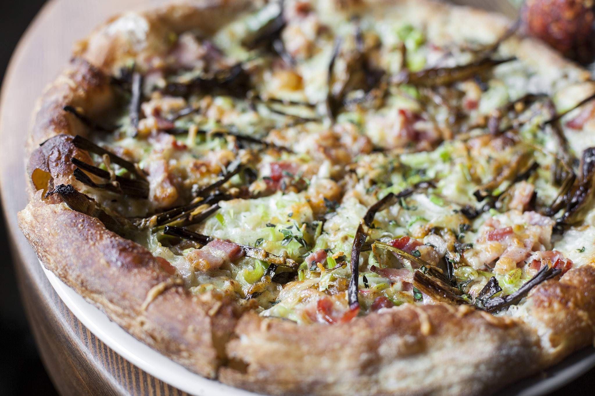 Spring onion and smoked bacon pizza at Stella Barra