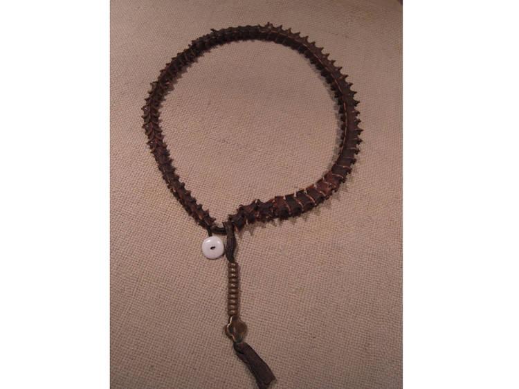 Snake-spine and human-cranium prayer beads at Rubin Museum of Art