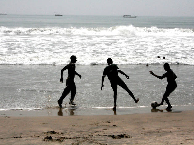 Playing football on Kokorobite Beach near Accra, Ghana
