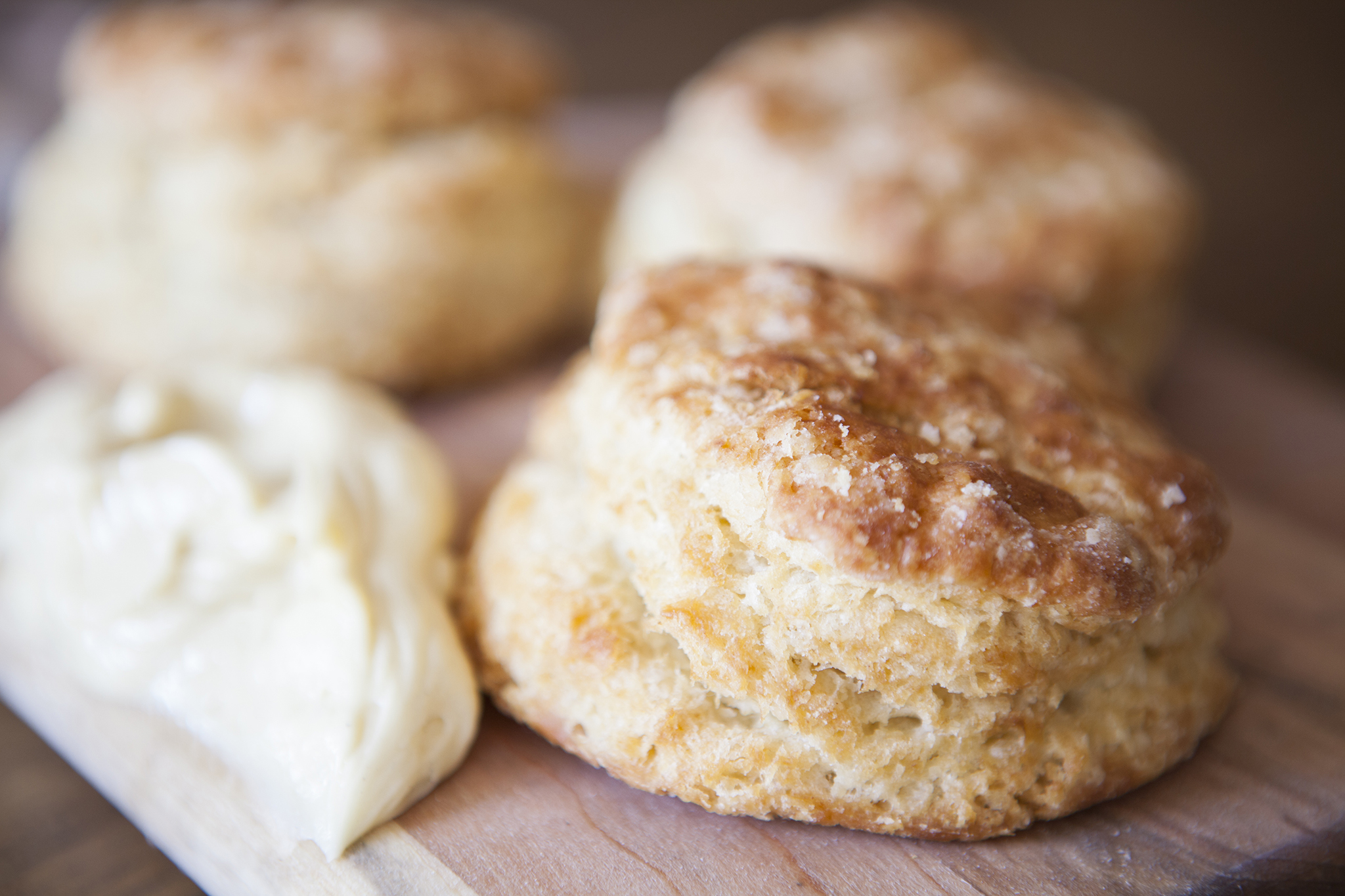 <p>Buttermilk biscuits with orange honey butter at Willie Jane</p>