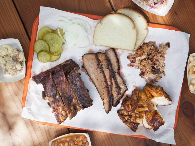 <p><em>Left to right</em>: Blue cheese and bacon potato salad, pork ribs, heirloom beans, brisket, chicken, pulled pork, jicama slaw and mac and cheese at Horse Thief BBQ</p>