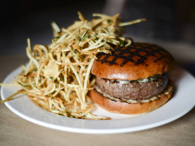 Chargrilled burger with Roquefort cheese at the Spotted Pig, NYC