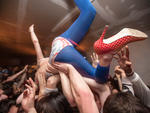 Callie W. crowd surfing during a Spank Rock show at Bodega. Bushwick, Brooklyn, 2009