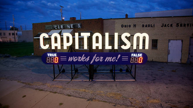 Capitalism Works For Me! (True/False) by Steve Lambert, appears in Times Square as part of Crossing the Line 2013
