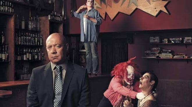 Mick Napier oversees a reenactment of a famous Co-Ed Prison Sluts scene, in which a clown fights a drag queen (Annoyance regulars Clay Goodpasture and Kyle Dolan, respectively), while an inmate (veteran Annoyance actress Ellen Stoneking) looks on.